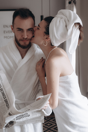 Guy in a white coat and a girl in a towel