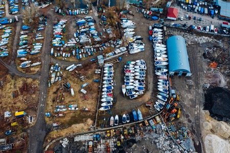 Aerial view of boat yard on land. Stored ships during winter time