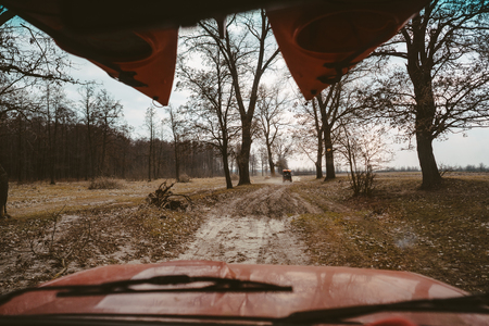 SUV driving on a dirt road view through the windshield Imagens