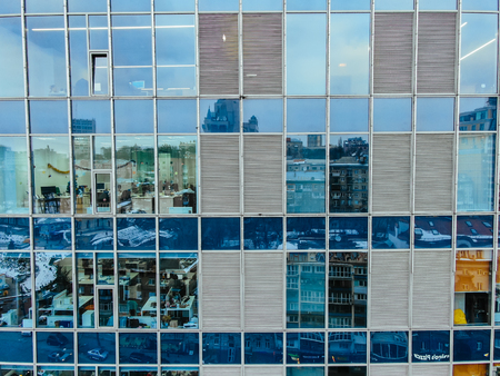 Street reflection on glass steel building facade, close view