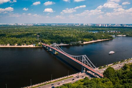 Pedestrian bridge in Kiev across the river to the park Фото со стока