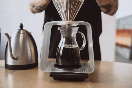 Close up of a barista making hand brewed coffee.