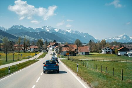 Car driving on the highway with mountains in the background 版權商用圖片 - 128854991