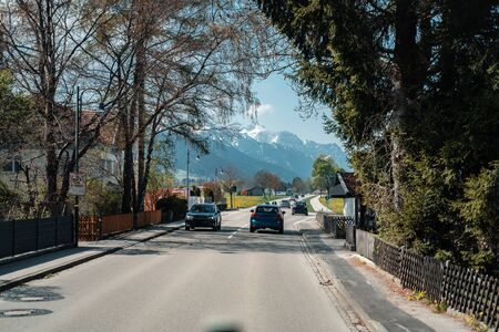 Car driving on the highway with mountains in the background 版權商用圖片 - 128854997