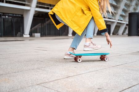 Teens ride a skateboard in the city. Youth culture