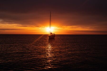Aerial view from drone on boat shipping in sea, sunset