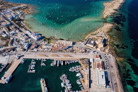 Beautiful turquoise bay at Formentera, aerial view. Banco de Imagens