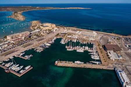 Beautiful turquoise bay at Formentera, aerial view. Banco de Imagens - 132124824