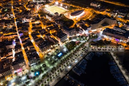 Beautiful aerial view of the night city. Ibiza is a famous destination for young people in Europe.
