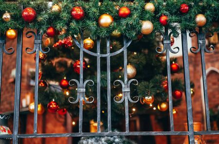 Christmas decoration lies on the forged railing. Close-up.