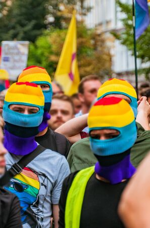 People in lgbt masks at an LGBT rally