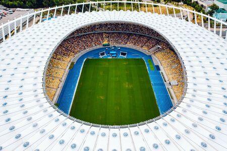KIEV, UKRAINE - JULY 30, 2019: Aerial view of the Olympic Stadium and Kiev city.