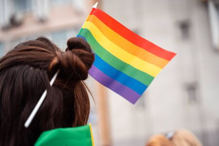 Photo of a girl with braided lgbt flag in her hair 写真素材