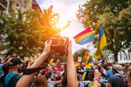 Correspondent takes photo during the Gay Pride parade