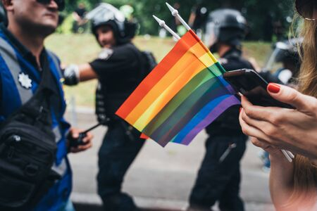 Hand hold a gay lgbt flag at LGBT gay pride parade festival