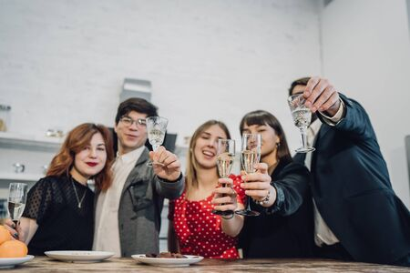 Happy colleagues in office celebrate special event. Stock Photo