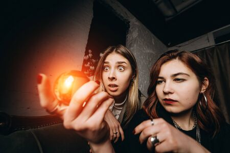 Woman and woman fortune teller with crystal ball