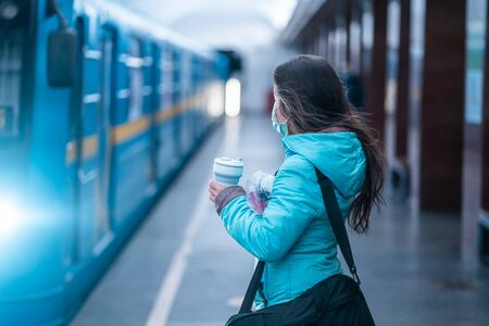 Woman wait at a subway station in Kiev.