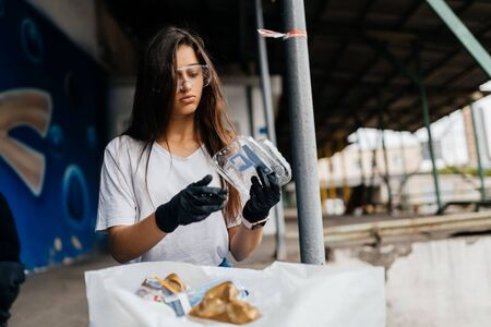 Young woman sorting garbage. Concept of recycling. Zero waste