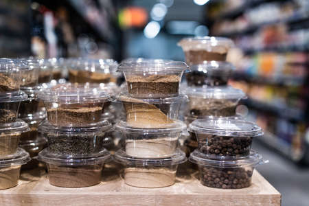 various spices and herbs packed in small transparent plastic boxes Reklamní fotografie