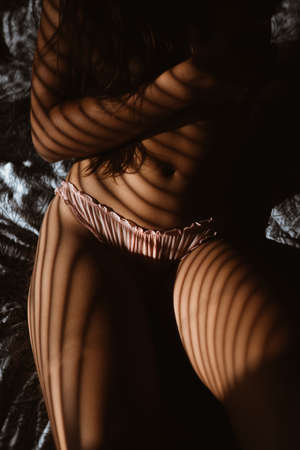 Sexy girl in bed.Silhouette photo.