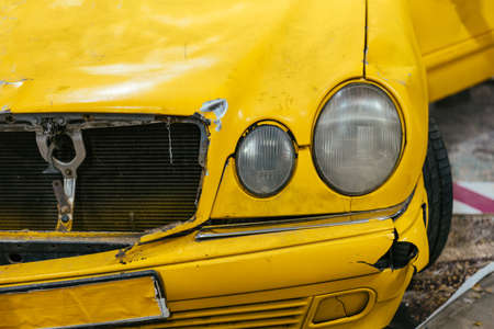 Close up of a Yellow car glass damage caused by accident.