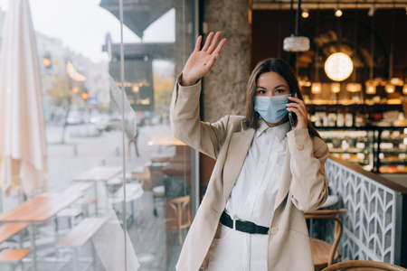 Business woman working in quarantine, speak by the phone.
