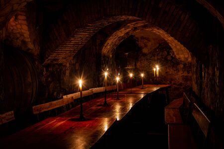 Underground cellar lit with candles, La Botica Vieja, Pe?a La Amistad de Aranda de Duero