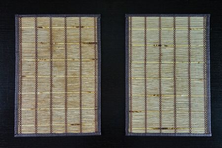 Wood bamboo mat on table, top view
