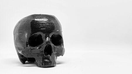 Black Human skull on isolated white background