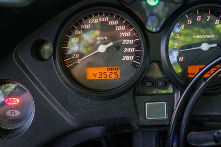 Speedometer of motorcycle on a open road from rider point of view Stock fotó
