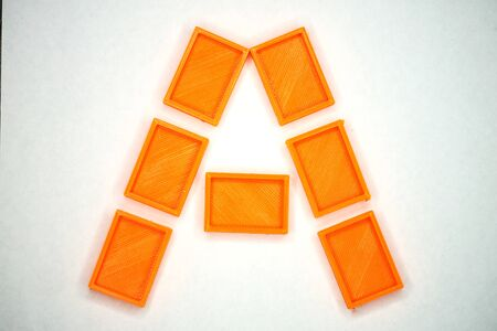 Latin alphabet letter A from orange briks
