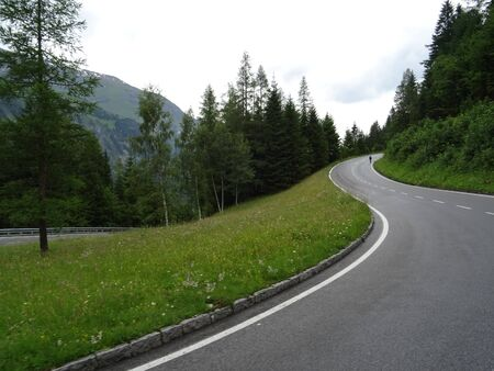 Turn the mountain road. Alps