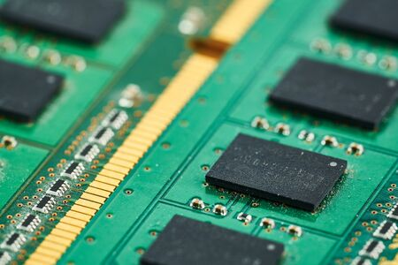 Electronic microcircuit with microchips and capacitors taken closeup