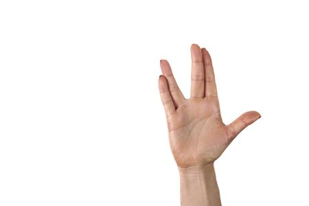 A man hand doing the Vulcan salute on a white background. Vulcan hand salute against. Spock hand. Alpha.
