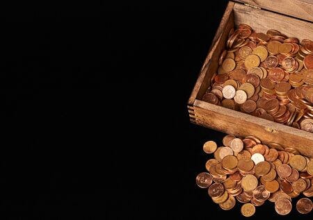 Euro coins in chest on black backgrtound. View from top. Archivio Fotografico