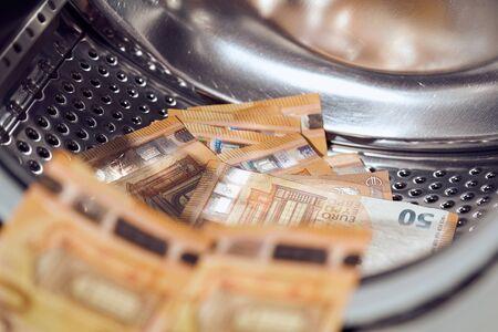 Money in washing machine, closeup view.