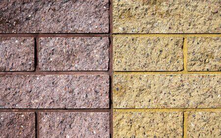 Yellow and pink bricks wall. Bricks texure. Brick background. 写真素材
