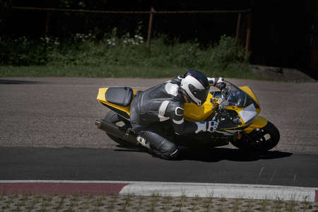 Man riding motorcycle in asphalt road curve with rural,motorcycle practice leaning into a fast corner on track 写真素材 - 150727239