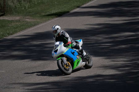 Man riding motorcycle in asphalt road curve with rural,motorcycle practice leaning into a fast corner on track 写真素材 - 150727379