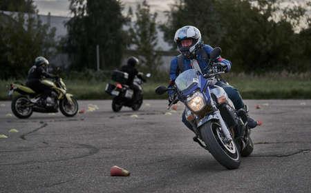 05-09-2020 Riga, Latvia Young man riding a motorcycle. Editorial