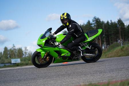10-05-2020 Ropazi, Latvia Motorcyclist at sport bike rides by empty asphalt road. sport bike. Editoriali