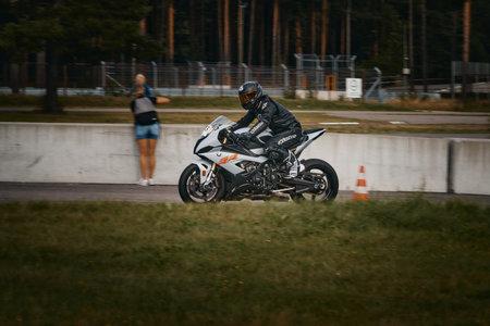 10-05-2021 Lithuania, Kaunas Moto rider, Motorcyclist rides at fast sport bike. Redactioneel