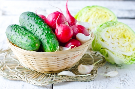 Fresh vegetables : radishes, cabbage , cucumbers and garlic photo