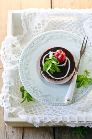 Mini cheese cake with cherries photo