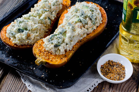 Pumpkin stuffed with couscous, zucchini and cheese Dorblu Stock Photo