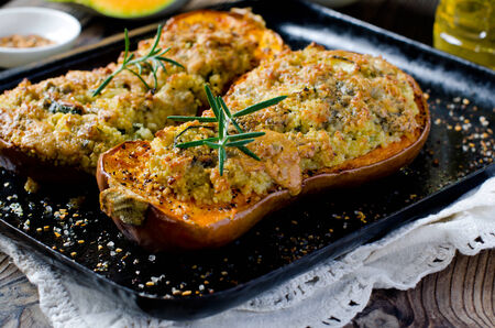 acorn seed: Pumpkin stuffed with couscous, zucchini and cheese Dorblu Stock Photo