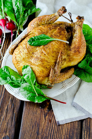 Baked chicken with spices and chard leaves