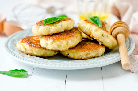 Cottage cheese pancakes with honey Stock Photo