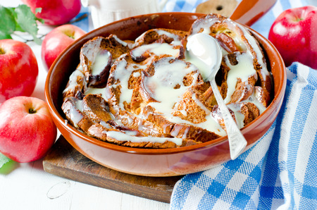 Bread pudding with apples and cream sauce